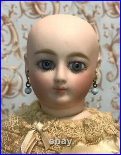 Rare Parisian poupee peau by luxury doll maker Louis Doleac